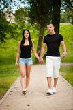 Teenage couple on a late summer afternoon in park Royalty Free Stock Photography