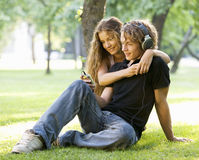 A teenage couple listening to music Royalty Free Stock Image
