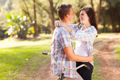 Teenage couple love. Happy teenage couple in love relaxing at the park Royalty Free Stock Photos
