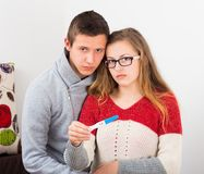 Teenage Couple With Positive Pregnancy Test. Teenage couple showing the result of their irresponsibility, positive pregnancy test Royalty Free Stock Photography