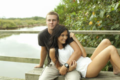 Teenage couple by river Royalty Free Stock Photo