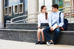 Teenage Couple in School Yard royalty free stock images
