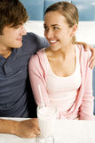 Teenage couple sharing a milkshake sitting in a diner Stock Photo