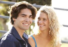 Teenage Couple Sitting On Steps. Smiling Royalty Free Stock Images