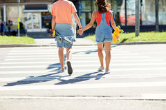 Teenage couple with skateboards at city crosswalk Royalty Free Stock Photography