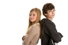 Teenage couple standing back to back Royalty Free Stock Images