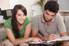 Teenage couple studying Royalty Free Stock Image