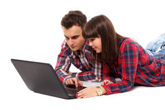 Teenage couple studying together. Two teenagers studying together with a laptop Royalty Free Stock Images