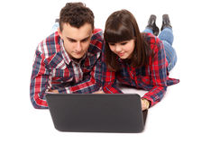 Teenage couple studying together. Two teenagers studying together with a laptop Stock Photography