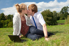 Teenage couple using laptop Royalty Free Stock Photography