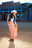 Teenage Cowgirl Adjusts Skirt Royalty Free Stock Images
