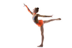 Teenage dancer girl working out. Beautiful happy gymnast athlete teenage girl wearing dancer colorful leotard working out, dancing, posing, doing balance art stock images