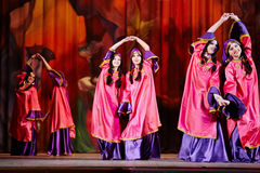 Teenage dancing collective dressed in oriental dress dances Royalty Free Stock Photo