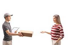 Teenage delivery boy giving a package to a young woman. Teenage delivery boy giving a package to a young women isolated on white background Stock Photography