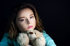 Teenage depression girl with a toy bear Royalty Free Stock Photography