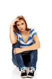 Teenage depression woman sitting on the floor Royalty Free Stock Image