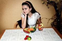 Teenage Diet. A beautiful teenage girl having healthy diet meal consisting of cucumber, tomato & sweet pepper salad, and tomato juice Stock Photography