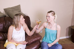 Teenage Drinking Caught by Mother. Mother Taking a Drink Away from Her Teenage Daughter Stock Photos