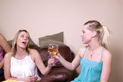 Teenage Drinking Caught by Mother. Mother Taking a Drink Away from Her Teenage Daughter Royalty Free Stock Image