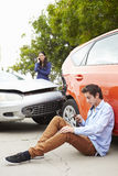 Teenage Driver Making Phone Call After Traffic Accident Royalty Free Stock Photography