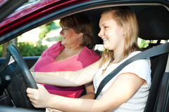 Teenage Driving Lesson. Teenage daughter gets a driving lesson from her mother or an instructor Stock Image