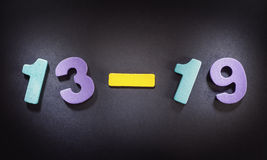 Teenage Era. Colorful wooden numbers, composition illustrates age of teenager royalty free stock images