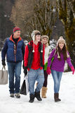 Teenage Family Carrying Shopping Along Street Royalty Free Stock Images