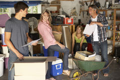Teenage Family Clearing Garage For Yard Sale Royalty Free Stock Photography