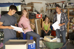 Teenage Family Clearing Garage For Yard Sale Stock Photography