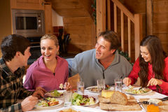 Teenage Family Enjoying Meal Stock Image