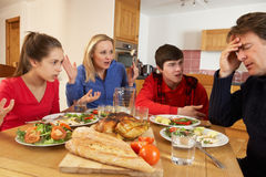Teenage Family Having Argument. Whilst Eating Lunch Together In Kitchen Stock Images