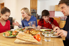Teenage Family Having Argument Whilst Eating Lunch. Together In Kitchen Royalty Free Stock Photos