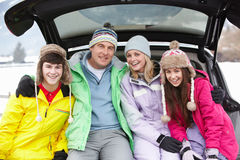 Teenage Family Sitting In Boot Of Car Royalty Free Stock Photos