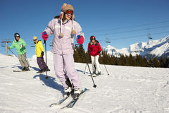 Teenage Family On Ski Holiday In Mountains royalty free stock photography