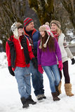 Teenage Family Walking Along Snowy Street Stock Photos