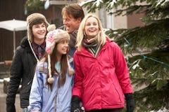Teenage Family Walking Along Snowy Street Stock Photos