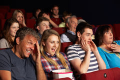 Teenage Family Watching Film In Cinema Royalty Free Stock Photography