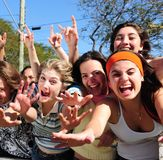 Teenage fans screaming. Crowd of crazy teen girls celebrating a famous star on the red carpet royalty free stock photo