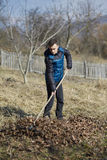 Teenage farmer spring cleaning Royalty Free Stock Photo