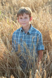 Teenage farmer standing among barley field Royalty Free Stock Photo