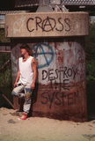 Teenage fashion. Teenager in urban outfit, next to graffiti royalty free stock images