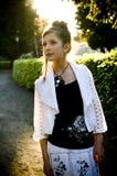 Teenage fashion girl and sun backlight Royalty Free Stock Image