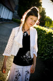 Teenage fashion girl and sun backlight Stock Image