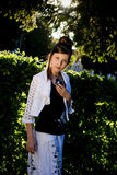 Teenage fashion girl and sun backlight Stock Images