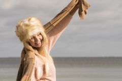 Fashionable woman on beach stock photo