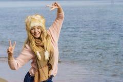 Fashionable woman on beach stock photography