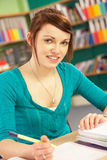 Teenage Female Student  In Classroom Royalty Free Stock Photography