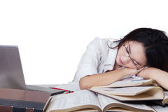 Teenage female student sleeping above books Stock Image