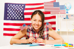 Teenage female student with two flags of USA Stock Image
