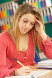 Teenage Female Student In Working In Classroom Royalty Free Stock Photos
